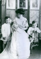 Princess Margaretha posing with her children and smiling.