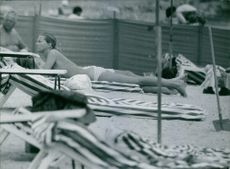 Princess Birgitta of Sweden and Hohenzollern, sunbathing.