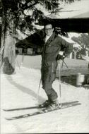 Roger Moore on slalom skiing during a ski holiday in Gstaad with the family