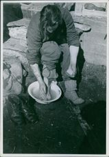 A Swedish Voluntary Corp washing his feet. Norway 1940