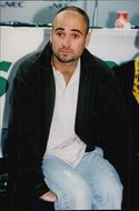 American tennis player Andre Agassi is watching when Pete Sampas wins the Davis Cup in 1995