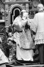 Pope Paul VI wiping his face.