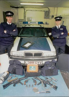 The sniper policemen Andre Halliday and Patrick Kelly with their weapons