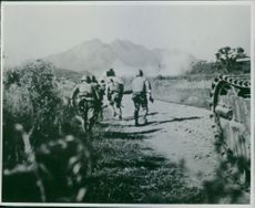 Japan-China War 1937-1945 Soldiers running towards the war zone, a tanker as back-up