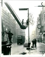 Christmas season workmen began erecting decorative chandeliers.