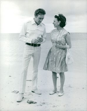Princess Margaret with her husband Antony Armstrong-Jones talking on the beach shore.  - 1967