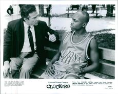 """Rocco Klein (Harvey Keitel), seated with Strike Dunham (Mekhi Phifer) on his """"office"""" bench, refuses to believe the clocker's protestations of innocence in the 1995 American crime drama film """"Clockers""""."""