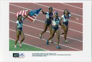 Inger Miller, Gwen Torrence, Chrystie Galnes and Gail Devers after the 4x100m win at the Atlanta Olympic Games in 1996