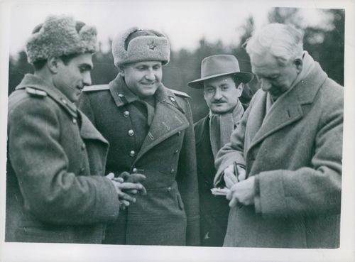 Sir Walter Citrine autographing Reichmark notes for Russian officers, Lt. Sergeev and Col. Tulpanov.