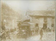 Soldiers standing in the destructed village, reconstructing.