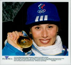 Portrait image of Yulia Chepalova from Russia, gold medalist in the 30 km long-distance skiing.