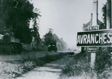U.S. armored spearhead charges through Avranches.