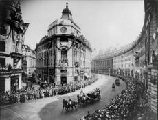 The King and Queen are in the royal wagon through Regent Street in London - 11 July 1927