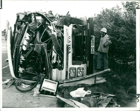 road accidents:the fireman looking at the mangled wreckage.