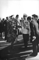 Mohammad Reza Pahlavi welcomes Juliana of the Netherlands when she visits in Tehran.