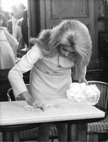Catherine Deneuve writing.