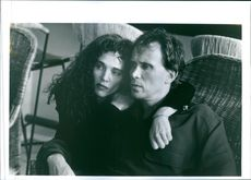 """Judy Davis and Peter Weller in a scene from the film """"The New Age""""."""