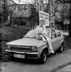 Lena Jacobsson is sitting on one of the winning cars in the Open Junior Cup 1977
