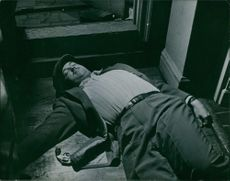 "Man mysteriously lying lifeless on the floor.  ""Murder mystery in Lild"""