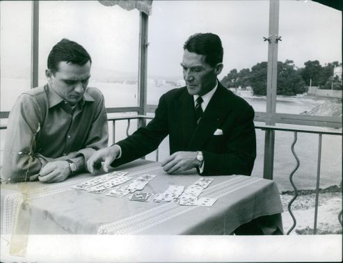 Two men playing cards.