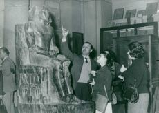 People looking up on an Egyptian Pharaoh statue.  - Jan 1961