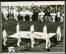 "The Olympic flag is brought into the stadium of the German ""Wunder-acht"", the rowing-eagle who won in Mexico during the opening of the 1972 Olympic Games"