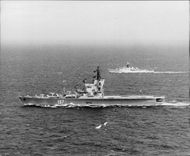 "The Russian helicopter cruiser ""Leningrad"" is shaded by the Royal Navy frigate while driving in the English Channel"
