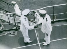 British and French C.-in-C's greeting each other on board a French battleship.