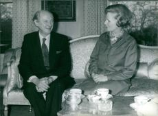 Jack Lynch and Mrs. Thatcher sitting on a sofa, conversing. 1978