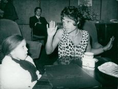 Eartha Kitt with her eight-year-old daughter at the airport