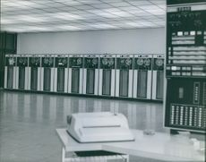 An empty room with machines lined up.