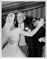 Mrs. John F. Kennedy is dancing with Jospeh Kennedy on her wedding day