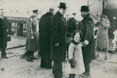 Crown Prince Gustaf Adolf on arrival at Copenhagen where he is greeted by Crown Prince Frederik and Little Princess Margrethe