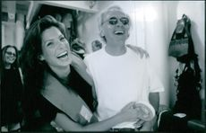 Jan de Bont and Sandra Bullock sharing a laugh on the set of Speed 2: Cruise Control.
