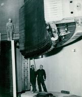 Stornorrfors. Section of the stator to one of the machines is lowered to its place