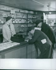 Men standing on the tobacco shop.
