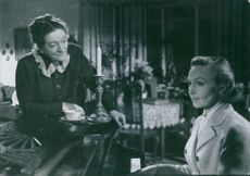 "Hjördis Petterson and Inga Tidblad in a scene from a 1951 Swedish drama film, ""Divorced."""