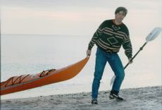 Willie Kennedy Smith with his kayak near the family home in Hyannisport