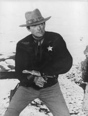 Frank Andersson pointing gun.