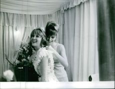 The woman dressing up the beautiful lady.1981