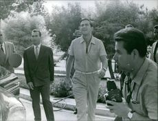 Constantine II walking while the other people looking at him, 1965.