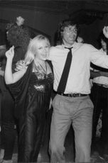 Actress Charlene Tilton with tennis player Ilie Nastase at nightclub Xenon Disco
