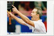John McEnroe protests to the referee during the final of the ATP Seniors Tournament against Guy Forget