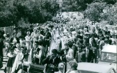 A photo of a parade during famous french hairdresser Alexander's son Michel Raimon and Evelyne de Beschart wedding, at the back is princess Grace of Monaco follows the couple. 1970