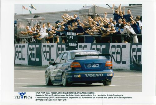 Rickard Rydell wins the first race in the Silverstone BTCC competition.