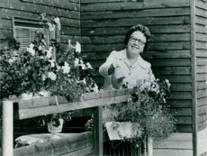 Sandviken, Bruket. Mrs Ruth Johansson, out on her flowering balcony
