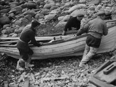 Three lobstermen from Radwick take their boat, Orkney.