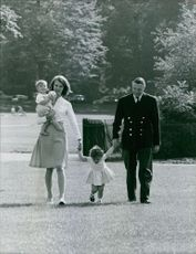 Princess Margaretha and John Ambler walking with their children.