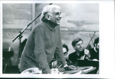 Year ? Portrait of  an American composer, conductor, author, music lecturer, and pianist Leonard Bernstein laughing.