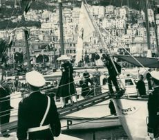 Grace Kelly and Prince Rainier leave the royal hunt after arriving at Monaco's port